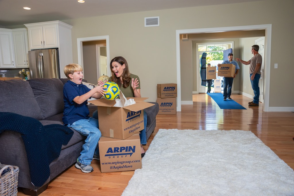 Happy family unpacking in new home