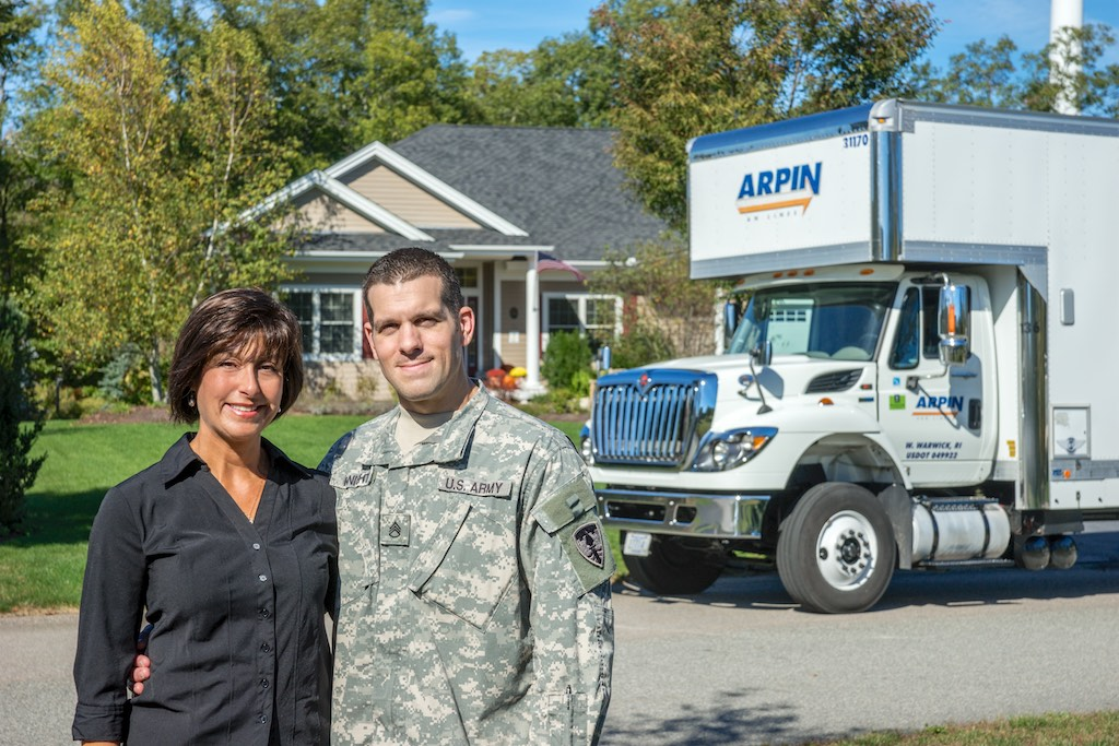 military couple outside of house with Arpin truck