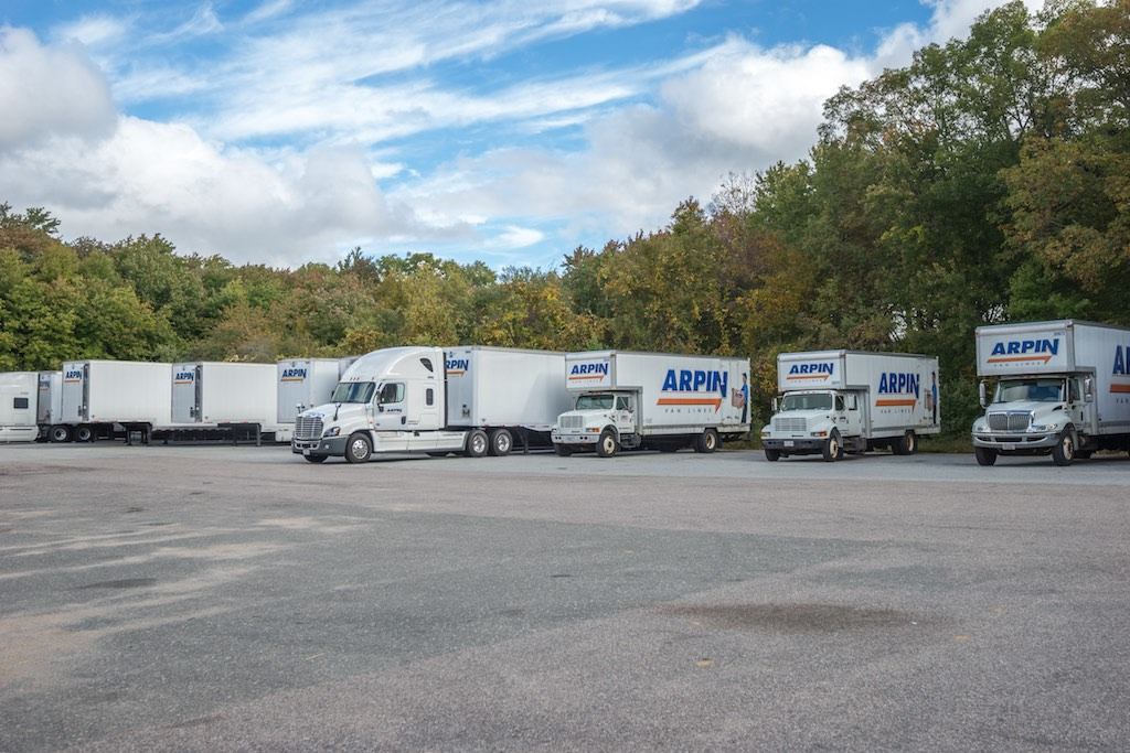 Fleet of Arpin trucks in a parking lot