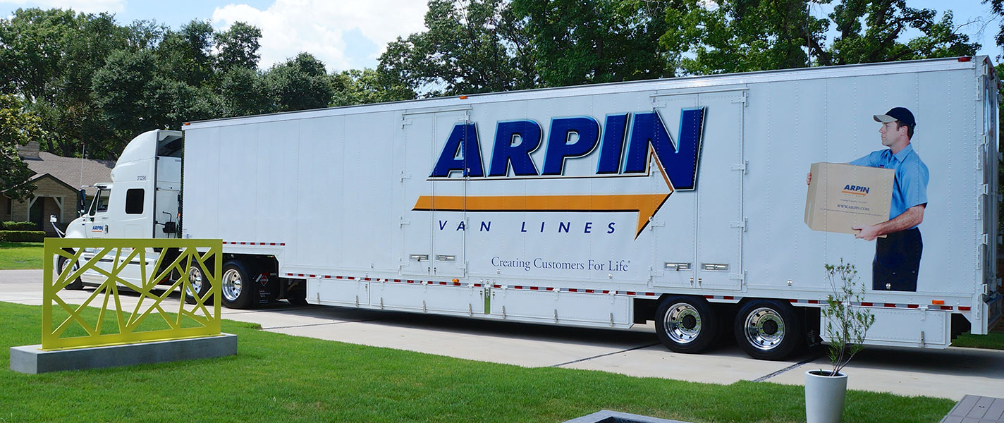 Arpin truck parked in a neighborhood