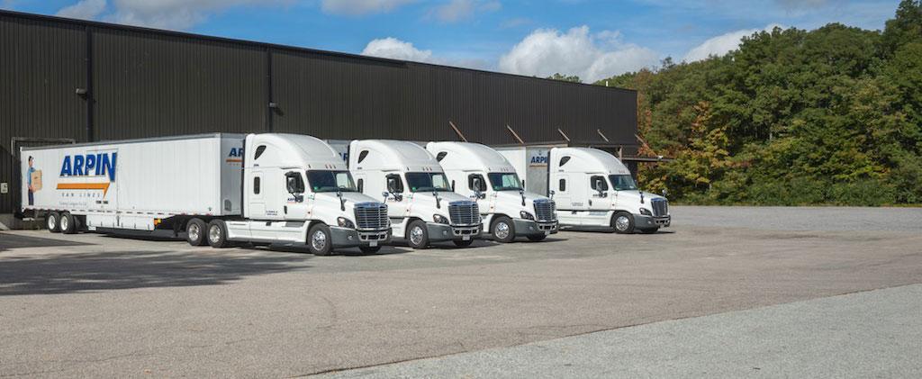 4 Arpin Trucks parked