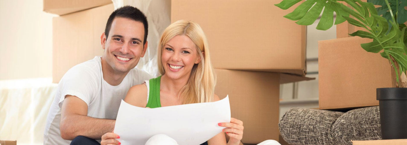 Happy Couple in front of moving boxes